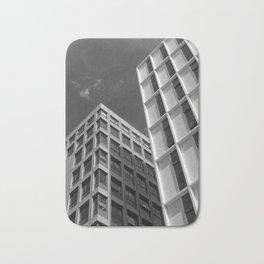 monochrome white concrete buildings Bath Mat