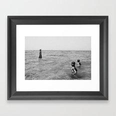 girls swimming in the sea Framed Art Print