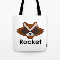 rocket raccoon Tote Bags featuring Rocket by Pop Culture Fanatics