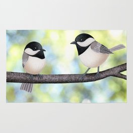 2 black-capped chickadees - bokeh Rug