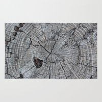 tree rings Area & Throw Rugs featuring Rings by Elizabeth Velasquez