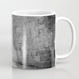 Street photography of a man in the rain in a building of the middle evo Coffee Mug
