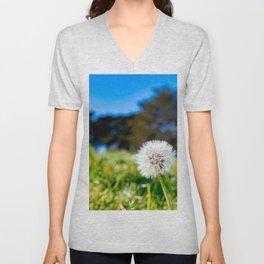 Beautiful dandelion flower close up with green grass background. Macro shot of dandelion flower Unisex V-Neck