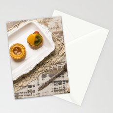 Three fruit tarts presented on an elegant antique china plate Stationery Cards