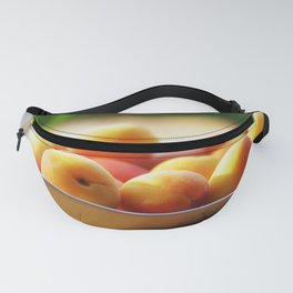 fresh apricots on the table Fanny Pack