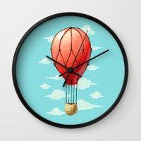hot air balloon Wall Clocks featuring Hot Air Balloon by Freeminds