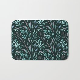Branches with leaves on dark background Bath Mat