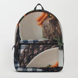 A beef steak with vegetables Backpack