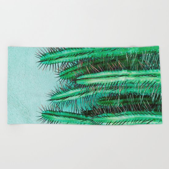 A prickly cactus on concrete Beach Towel