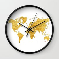 vintage map Wall Clocks featuring World Map Gold Vintage by City Art Posters