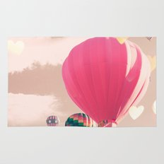 Hot air balloon and heart bokeh on pale pink Rug
