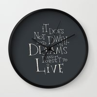 "dumbledore Wall Clocks featuring Harry Potter - Albus Dumbledore quote ""It does not do to dwell on dreams""  by SimpleSerene"