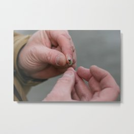 Weathered hands tie on a fly Metal Print