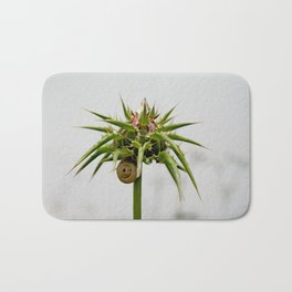Thistle bud and snail Bath Mat