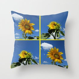 big sunflower shines yellow against a blue sky with white clouds Throw Pillow