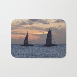 Sailing into the sunset Bath Mat
