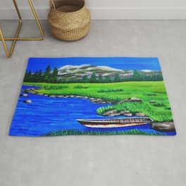 River bank with little old boat Rug