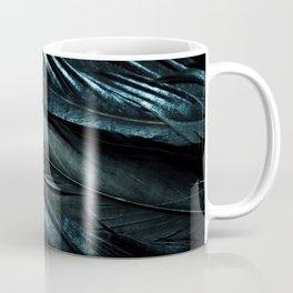 Blue feathers on black background Coffee Mug