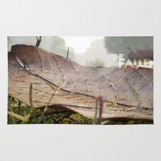 Dew drops on a fallen leaf Rug