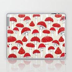Red mushrooms on the light background Laptop & iPad Skin