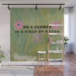 A Flower In A Field Of Weeds Wall Mural