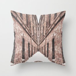 walkway in the middle of the brown brick buildings Throw Pillow