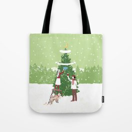 Decorating a tree Tote Bag