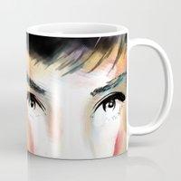audrey hepburn Mugs featuring Audrey Hepburn by caffeboy