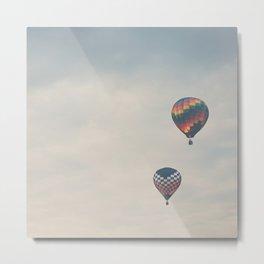 a pair of hot air balloons flying away ...  Metal Print