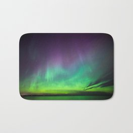 Northern lights over lake in Finland Bath Mat