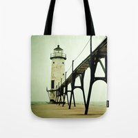 waves Tote Bags featuring Manistee Light by Olivia Joy StClaire