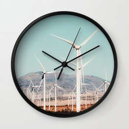 Wind turbine in the desert at Kern County California USA Wall Clock