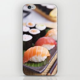 Various Japanese sushi on a plate, shallow depth of field iPhone Skin