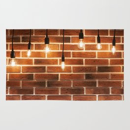brick wall and decorative incandescent lamps Rug