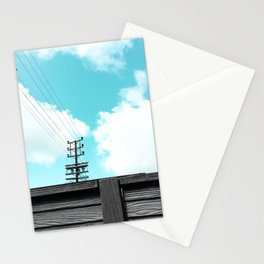 electric pole with wooden wall and blue cloudy sky in the city Stationery Cards