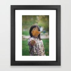 Girl holding leaf Framed Art Print
