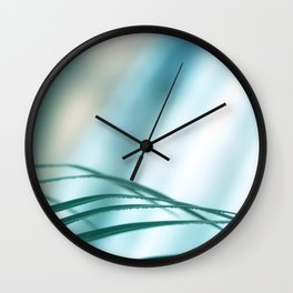 Blade of grass leaves defocused with copy space blue background Wall Clock