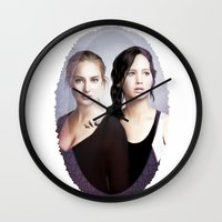 divergent Wall Clocks featuring The Divergent Games by Clara J Aira