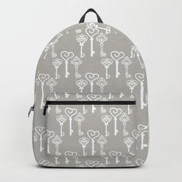 Vintage keys on a gray background Backpack