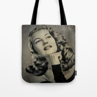 wasted rita Tote Bags featuring Rita by Nano Barbero