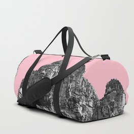 Part of Angkor Wat with pink Duffle Bag