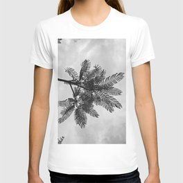 Tropical leaves against a sunset sky in black and white T-shirt