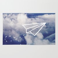 plane Area & Throw Rugs featuring Paper Plane by Leah Flores