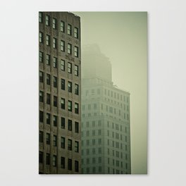 Buildings in downtown New York covered by mist Canvas Print