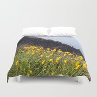 big sur Duvet Covers featuring Yellow Poppies in Big Sur by World Photos by Paola