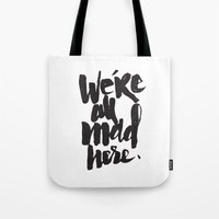 mad Tote Bags featuring ...MAD HERE by Matthew Taylor Wilson