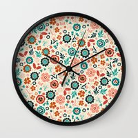 folk Wall Clocks featuring Folk Flowers by Anna Deegan