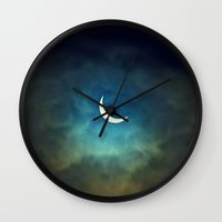 clouds Wall Clocks featuring Solar Eclipse 1 by Aaron Carberry