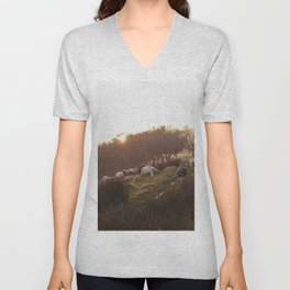 Sheep grazing on hillside at sunset. Derbyshire, UK. Unisex V-Neck