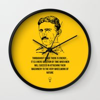 tesla Wall Clocks featuring Tesla Quote  by Purshue